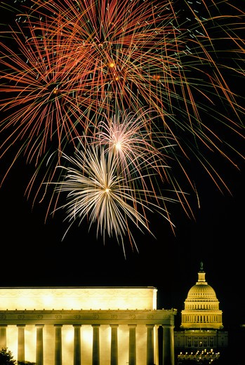 Fourth of July fireworks burst over the Lincoln Memorial and Capitol, Washington, DC. : Stock Photo