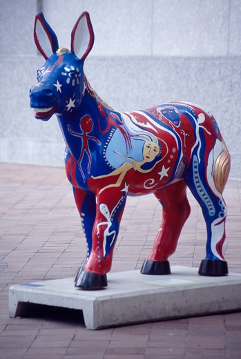 Stock Photo: 4286-32086 Imaginatively painted statue of a (Democratic) donkey, part of the 'Party Animals' art series on Washington DC sidewalks.