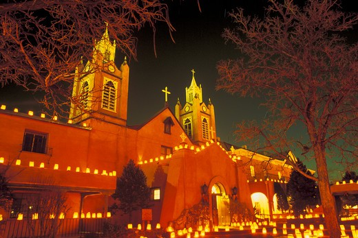 Stock Photo: 4286-32138 Evening shot of San Felipe de Neri Church with luminarias on Christmas Eve in Old Town, Albuquerque, NM.