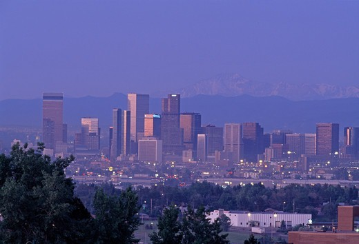 A spring dawn view of Denver's skyline with Pike's Peak in the background, Denver, CO : Stock Photo