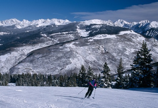 Downhill skier on slopes near the Gore Range, Vail, Colorado : Stock Photo