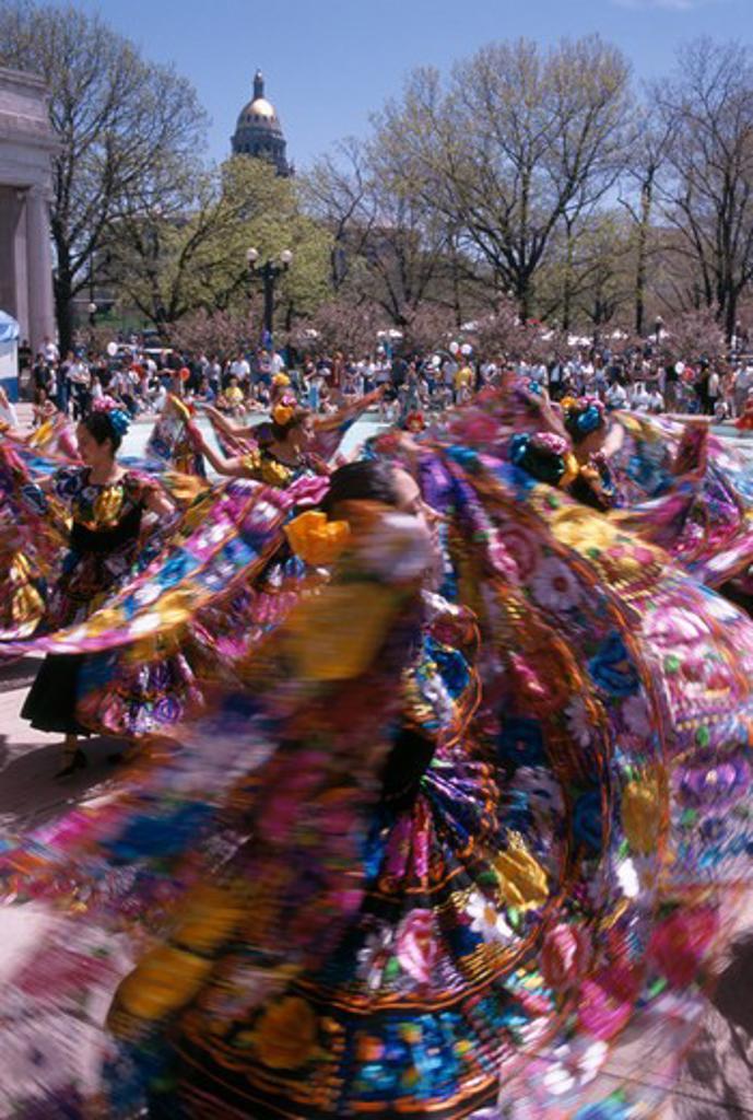 Colorful dancers fill Civic Center Park during a Cinco de Mayo celebration, Denver, CO : Stock Photo