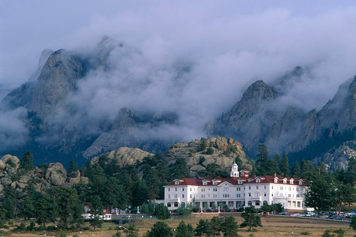 Stock Photo: 4286-33053 Storm clouds surround mountain-side above historic Stanley Hotel, Estes Park, CO