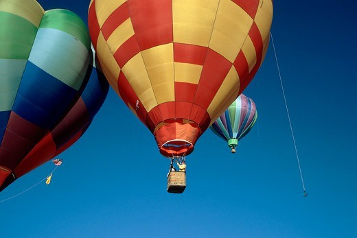 Two hot air balloons gently touching : Stock Photo