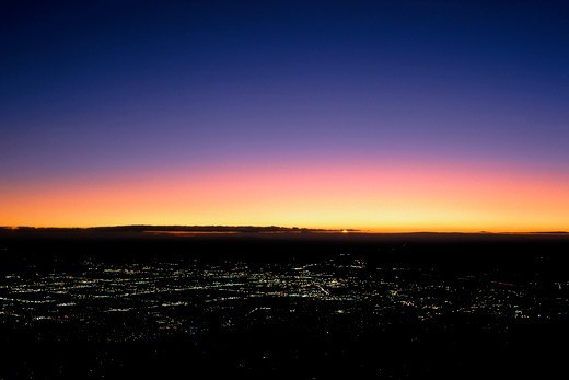 High above Albuquerque, New Mexico, as the sun sets : Stock Photo