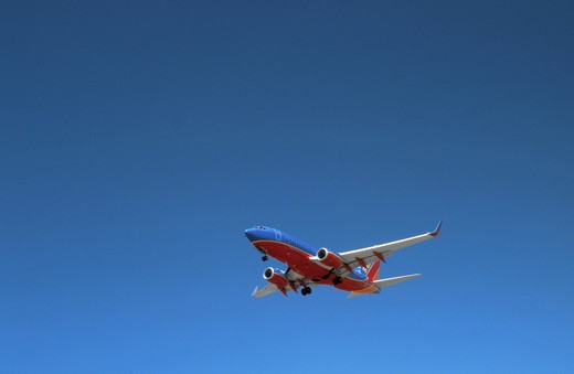 A richly colored Southwest Airlines Boeing 737 approaches landing at LAX, Los Angeles : Stock Photo