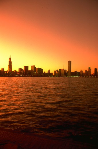 Chicago skyline with Lake Michigan in foreground at sunset, posterized. : Stock Photo