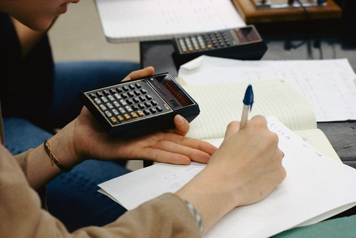 Student doing classwork in Physics class, Georgetown University, Washington, DC. : Stock Photo