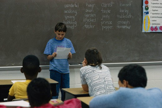 Fourth grade students read reports aloud to class.  (model released) : Stock Photo