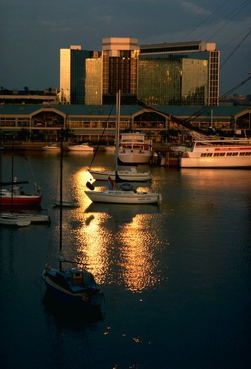Stock Photo: 4286-34984 Sunrise on boats in Baltimore Inner Harbor, near Harbor Place shopping center.