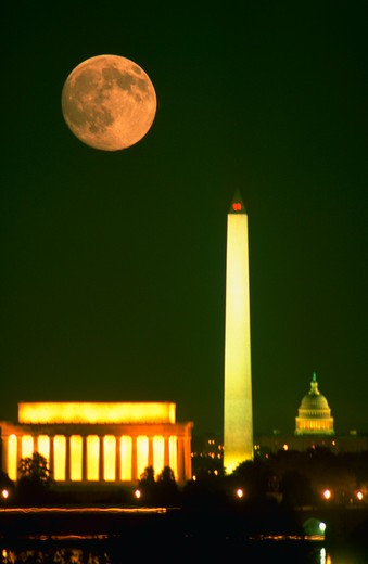 Stock Photo: 4286-35035 Moonrise over the Washington, DC skyline showing the Lincoln Memorial, Washington Monument and the U.S. Capitol. - DA37240