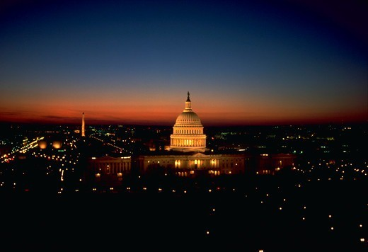 Stock Photo: 4286-35099 East front of the U.S. Capitol at night with the rest of Washington, DC behind it. - JP  2009