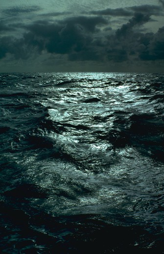 Stock Photo: 4286-35673 Oceanscape, with dramatic light.  Taken in the middle of the Pacific Ocean.  (Water Series.  Ocean.  Nature.)