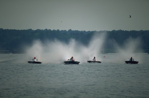 Stock Photo: 4286-35682 Hydroplane boats racing at Kent Narrows in the Chesapeake Bay.  Action shot showing heated head-to-head competition, and four boats in contention to win.  (Water Series.  Recreation.  Sports.  Boating.  Competition.)