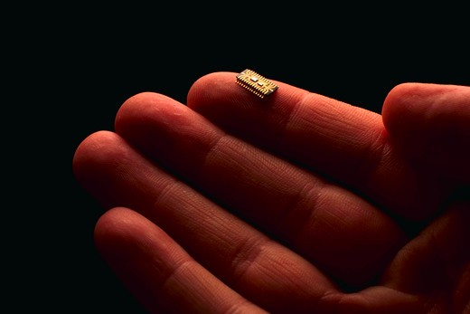 Stock Photo: 4286-35866 Microchip on fingertip.