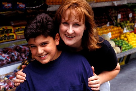 Stock Photo: 4286-36412 Portrait of a mother embracing her son.