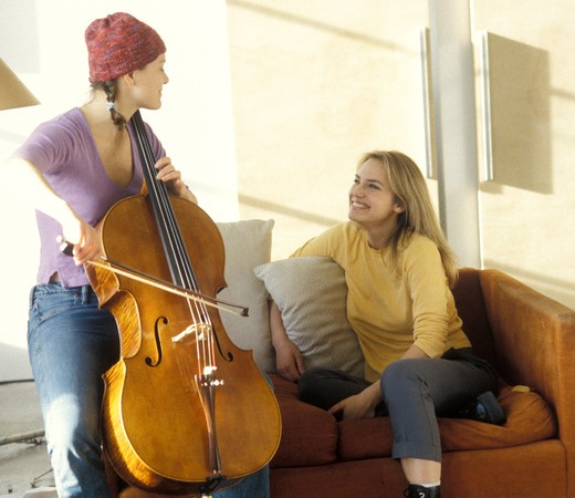 View of two women enjoying a music session. : Stock Photo