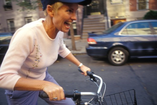 View of woman riding bicycle. : Stock Photo