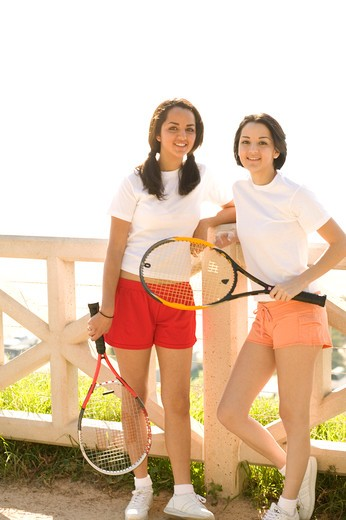 Stock Photo: 4286-38210 View of two friends holding rackets.