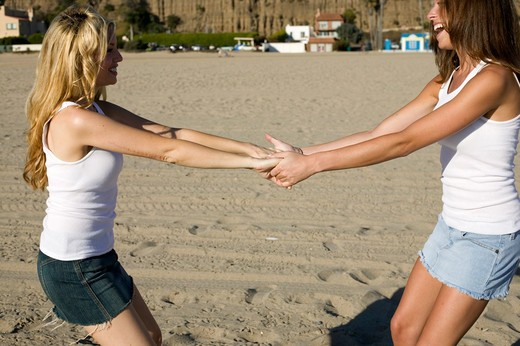 Stock Photo: 4286-38728 View of two women playing on a beach.