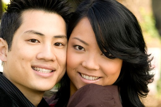 Stock Photo: 4286-39041 View of a happy young couple embracing.