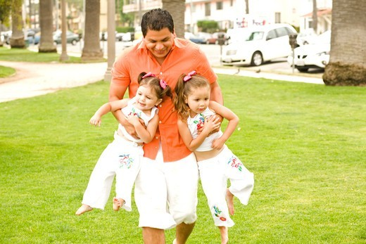 View of a father playing with his daughters. : Stock Photo