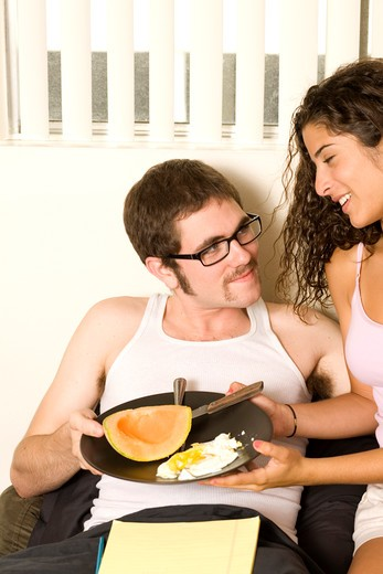 Stock Photo: 4286-39352 View of a couple with fruit and scrambled eggs.