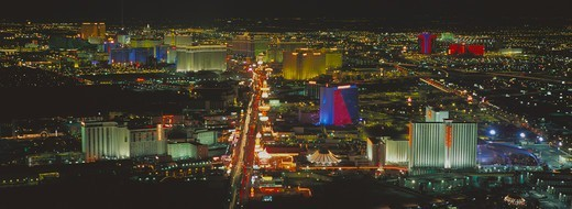 Stock Photo: 4286-39912 Panoramic nighttime aerial view of Las Vegas, looking down The Strip towards the brightly lit casinos.