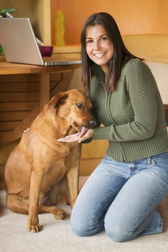 Stock Photo: 4286-40033 Young woman with labrador dog  MR-0429 PR-0419 MR-0403
