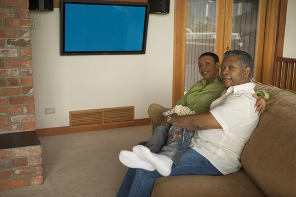 Stock Photo: 4286-40038 Seniors, African Americans. Watching plasma TV  MR-0509 MR-0510 PR-0505