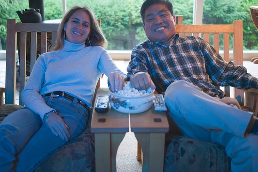 Mixed race couple watching TV  MR-0427 MR-0428 PR-0419 : Stock Photo