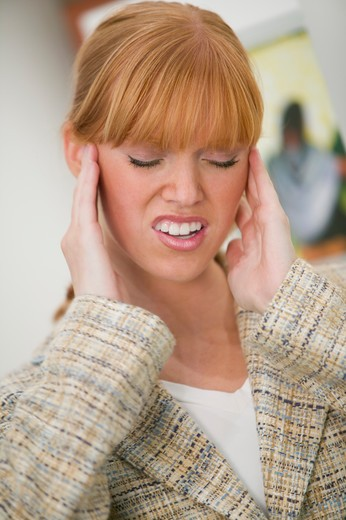 Stock Photo: 4286-40406 Woman with a tension headache.  MR-0439 PR-0442