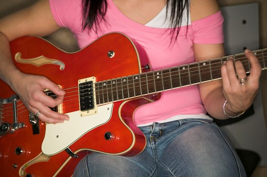 Woman and guitar.  MR-0535 PR-0536 : Stock Photo