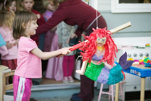 Stock Photo: 4286-41173 Children Trying to Break Open a Pinata at a Birthday Party