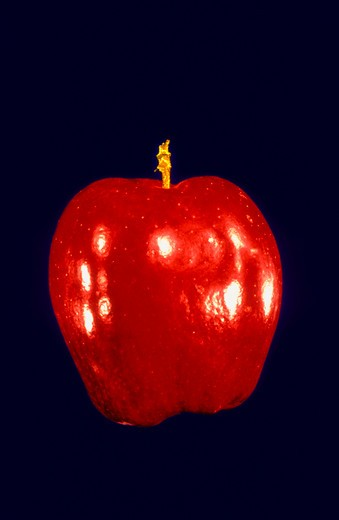 Stock Photo: 4286-41549 Red apple on a blue background.