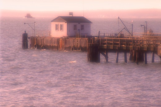 Boathouse on pier on the Patapsco River, Baltimore, Maryland, with soft focus effect. : Stock Photo