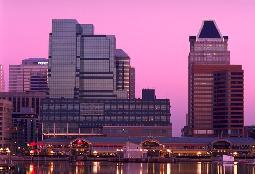 Stock Photo: 4286-41631 Skyscrapers of Baltimore skyline with Inner Harbor market and Baltimore Harbor in the foreground at sunrise.