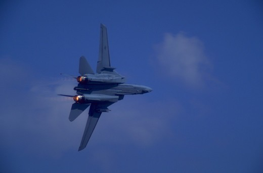 F-15 military airplane in flight against blue sky, Frederick, Maryland. : Stock Photo