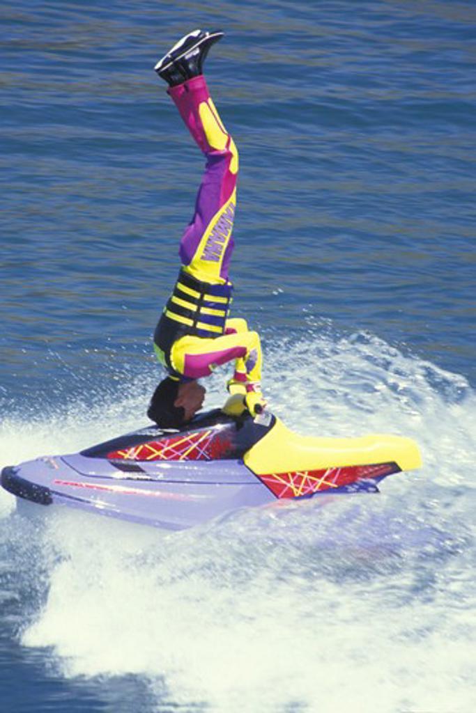 Stock Photo: 4286-41873 water skier show  up side down on jet ski Sea World San Diego California