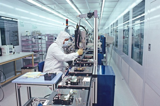 Stock Photo: 4286-42140 cleanroom disk hard drive manufacturing