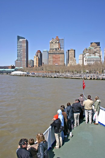 Stock Photo: 4286-42265 People on ferry boat arriving at Battery Park New York City