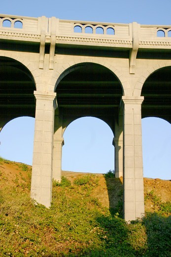 Arched supports Patterson Memorial Bridge highway 101 over Rogue River on coast at Gold Beach Oregon : Stock Photo