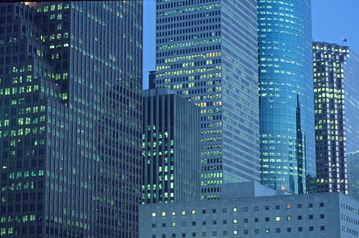 window lighting dusk downtown highrise office buildings Houston Texas : Stock Photo