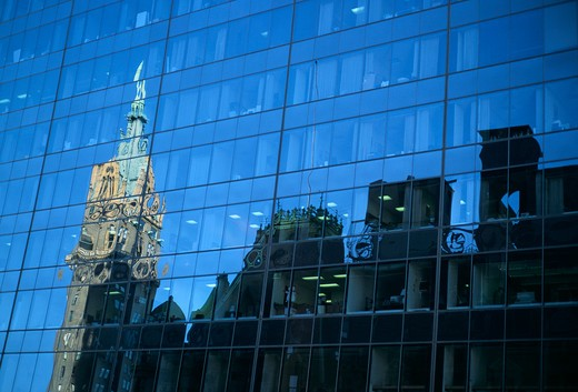 Stock Photo: 4286-43344 Reflections of skyline of buildings on glass office building, New York City.
