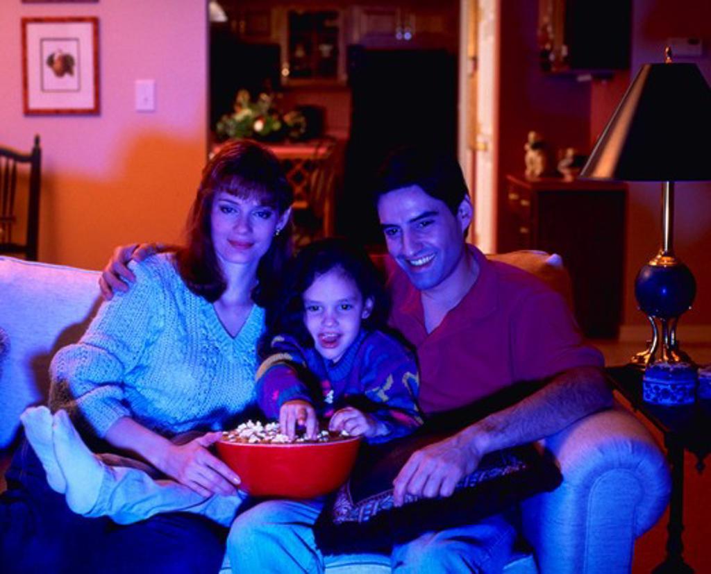 Family watching TV, MR : Stock Photo