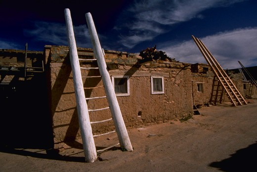 Stock Photo: 4286-44063 INDIAN ADOBE HOUSE WITH LADDERS TO HEAVEN IN ACOMA NEW MEXICO