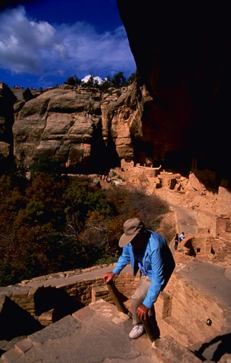 MESA VERDE COLORADO NATIONAL PARK WITH OLDER MAN CLIMBING : Stock Photo
