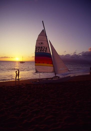 Stock Photo: 4286-46274 Couple with sailboat, Kaanapali, Maui, Hawaii