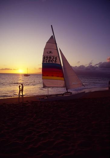 Couple with sailboat, Kaanapali, Maui, Hawaii : Stock Photo