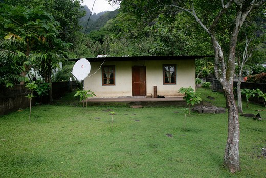 Satellite dish, Hanavave, Island of Fatu Hiva, Marquesas Islands, French Polynesia : Stock Photo